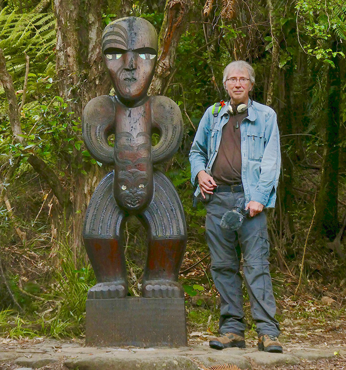 Clive Williamson with a Maori statue.